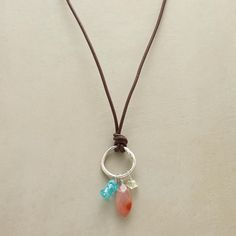"""CIRCLE AROUND NECKLACE--Everything's just peachy with our leather necklace knotted to hold a sterling circle and a trio of gems—orange agate, green quartz and apatite blue as the sky. Sterling silver clasp. Exclusive. 17"""" to 19""""L."""