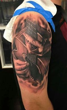Realistic Guitar Tattoo On Half Sleeve