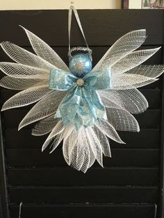Purchased item ~ Large Angels made out of Deco mesh and ribbons. Large enough to hang on a wall or door. Great for a gift topper. 11 inches in height and 13 inches wide. Christmas Mesh Wreaths, Christmas Angels, Christmas Fun, Christmas Decorations, Christmas Ornaments, Beautiful Christmas, Angel Crafts, Christmas Projects, Holiday Crafts