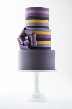 Purple striped wedding cake by AK Cake Design; photo: Lara Ferroni