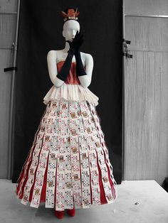This paper dress was inspired by the Tim Burton film Alice in Wonderland. The entire dress is constructed of paper except for the nylon gloves.
