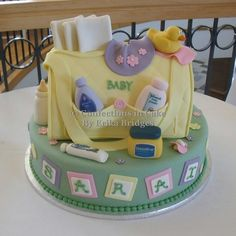 Yellow diaper bag cake with baby products