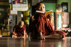 Two young monks studying in a monastery - stock photo