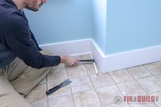 I locked the plank in place to the prior row close to the jamb. Then I used the tapping block on the end of the board until it slid all the way under the trim. Laying Vinyl Flooring, Installing Vinyl Plank Flooring, Vinyl Sheet Flooring, Luxury Vinyl Flooring, Luxury Vinyl Plank, Diy Flooring, Removing Baseboards, Painting Tile Floors, Floating Floor