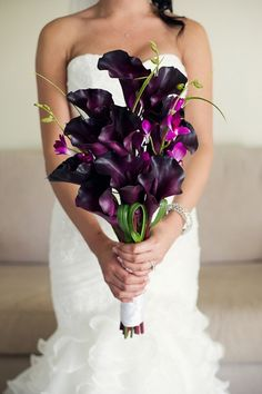 orchids and calla lilies - I think this is really very appropriate as well.  I love the hand tied, although maybe a few less calla lilies?