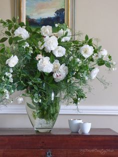 white roses and peas in a vase