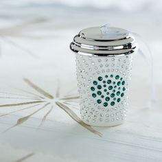 Limited edition ceramic white cup ornament set with Swarovski® crystals.
