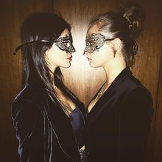 Kendall Jenner and Cara Delevingne in masquerade masks