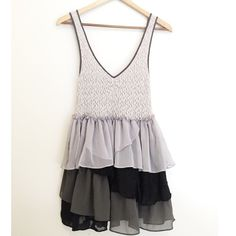"""Gray & Black Free People Dress This is a beautiful dress by Free people with a fitted upper and chiffon ruffle detailed bottom. The black ruffled area is lace and so pretty. Approximately 31"""" in length. Armpit to armpit approximately 12"""" but has some stretch to it. Price firm unless bundled. Free People Dresses Mini"""