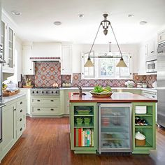 Loving the green island in this white kitchen!