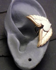 WINGED HEART Ear Cuff Mixed Metal- Sterling Silver & Brass. Super cute aprox. $38.00 with shipping :]