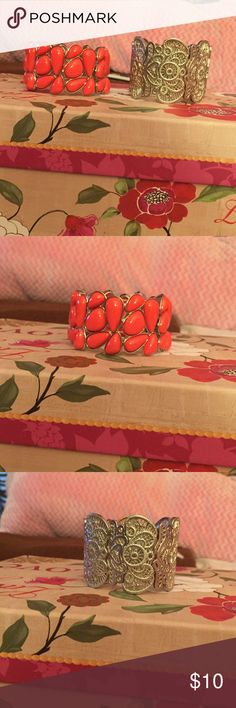 2 Silver Stretchy Bracelets 2 cute silver stretchy bracelets, only worn once or twice, still in great condition! One is all silver, the other has coral beads all around it, both are thick bracelets, both very pretty on! Jewelry Bracelets