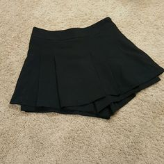 "black chic skort skirt high waisted mini new with tags size medium. waist 28"". very similar to the last image with model, but not the same, but very similar. only difference is mine, has a front panel, where the crotch is, which I think looks better. Skirts Mini"