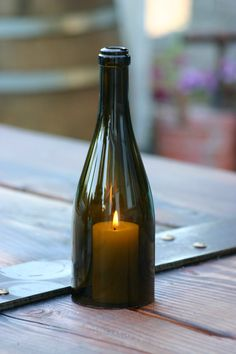 Wine Bottle Candles, I love this idea and with the amount of wine I drink...it should be easy to create my own!