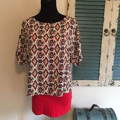 Cute boho zipper back layering  top This is one of my favorite pieces. Boho style with a zipper back. I have it paired with a red tank, but would work with blue, ivory, or gold too! Soft and silky and 100% poly. Mannequin is wearing a size small. Great colors. Smoke free home, fast shipping, and discounts on bundles. Prospero Tops Blouses