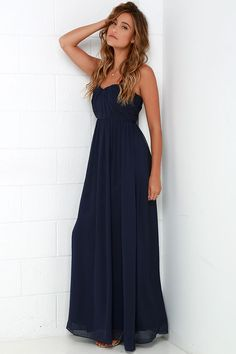 Every black tie event will be the perfect excuse to show off the Draw Her In Navy Blue Strapless Maxi Dress! A strapless sweetheart neckline, complete with no-slip strip, tops a fitted bodice with lightly padded cups and angular seaming along the Georgette fabric. Elegant maxi skirt descends from the fitted waistline. Hidden back zipper with clasp.