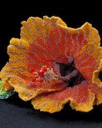 Suzen's Hibiscus, Brooch.  Glass seed beads, wire, nylon thread, sterling silver pin back. designer: karenpaust.com