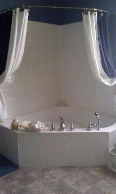 Custom Trimed Corner Jetted Tub Board And Batten Surround