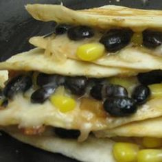 Black Bean and Corn Quesadillas - Allrecipes.com = Cheesy, a little bit spicy, and a little bit sweet—this Mexican favorite can be made easily for a quick dinner.