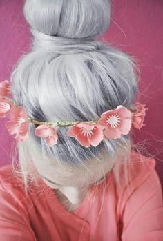white/silver hair Long in a bun. flower head band.