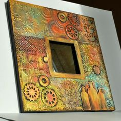 "Is this not gorgeous?  A quick ""how to"" make this from an Ikea mirror, embossing folders, die cuts, black gesso and Inka Gold paints. Eileen's Crafty Zone 2.19.14"