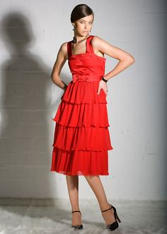 8b3d1703e A young woman wearing a red party dress