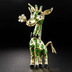 18K Enamel and Diamond Giraffe Brooch - Ever dream of a green giraffe? Well your dream's come true! From mid-twentieth century Italy, he's all dressed up in black tie and (a real) tail with a sparkling diamond boutonniere (in his mouth)! Beautifully crafted in 18K yellow gold and colored in green, black and white enamel and ruby eyes. He stands a towering 2 and 3/8 inches tall.