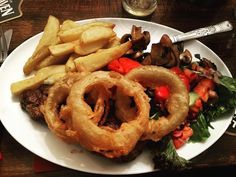 The #food at the Castle #Hotel in #Berwick-Upon-Tweed is outstanding. Underneath those giant #onion rings is a prime #sirloin #steak. Two of these plus a bottle of Sauvignon Blanc was a #bargain 30.00 and HUGELY recommended. #delicious #tasty #yummy #foodporn #instascran #chips #fries #salad #delicious #igersberwick #instascran #travel #tourism #tourist #leisure #life