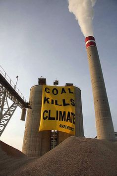"Greenpeace Indonesia placed a huge banner saying ""Coal Kills Climate"" to raise awareness about coal powered power plants. According to Greenpeace, plans to build new coal power stations around the world is the single biggest threat to climate change ."
