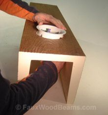 installing recessed lights into faux beams for your ceiling