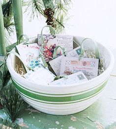 Use What You Have  Not into the traditional, bright red-and-green color scheme? Use what you have that fits with your decor and make it special. Our large mixing bowl, color-cued to the rest of the room, becomes home to vintage postcards or holiday greetings during December.