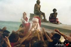 The Incredible Santa Claus arrives in San Pedro, Ambergris Caye by boat. Visit ambergristoday.com for more flashback pictures of Ambergris Caye.
