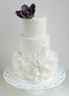 Get inspired: A delicately beautiful wedding cake bedecked with white florals, and topped with a deeply romantic purple flower! White Wedding Cakes, Beautiful Wedding Cakes, Gorgeous Cakes, Pretty Cakes, Amazing Cakes, Wedding Sweets, Cake Wedding, Elegant Wedding, Cupcakes