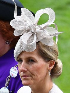 The Countess of Wessex, who has worn hats by Jane Taylor on many recent public engagements, this time chose a taupe sinamay hat with bow trim.