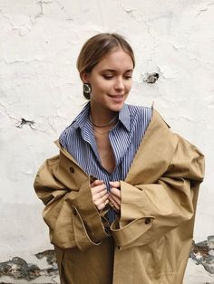 striped shirt, camel trench coat