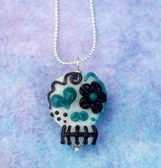 Flameworked, lampwork glass reversible sugar skull pendant. $30.00, via Etsy.