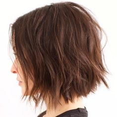 Brown Chopped Bob. I wish my hair was wavy. I want the shape and angle of this cut.