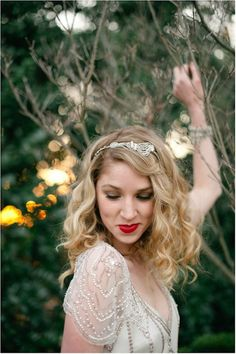 Gorgeous jeweled and embellished headband and a bright red lip.  Photo by Spindle Photography. www.wedsociety.com  #wedding #beauty #accessories