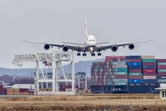 Airbus A380-800 (G-XLEE) First scheduled BA A380 flight to Boston. Landing between a cargo vessel and an AT-AT.