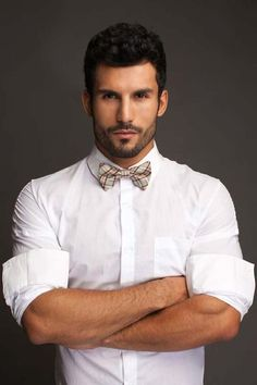 Classic white shirt with plaid bow tie.