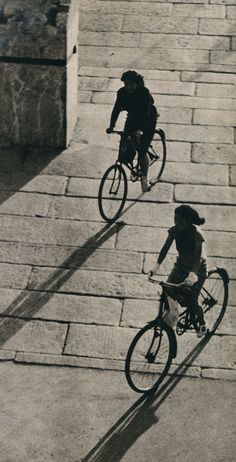 Women wearing Qipao rode bikes on streets of Beijing. (1939)