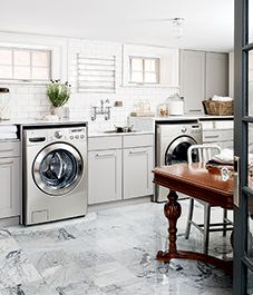 A spacious basement laundry room gets a multi-functional makeover.