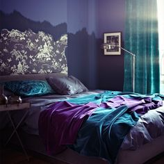 Dark and dramatic purple bedroom