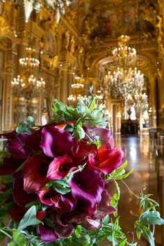 Red calla bouquet in Palais Garnier .