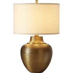 Seamlessly blending modern style with classic design, this eye-catching table lamp showcases a hammered design and an antiqued brass finish. Topped with a ha...