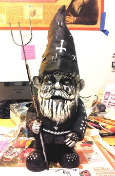 Hey, I found this really awesome Etsy listing at http://www.etsy.com/listing/102057709/black-metal-lawn-gnome