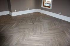 "Herringbone ""Yes its Tile"" Hardwood - modern - family room - burlington - Gino Dalesio Renovations"