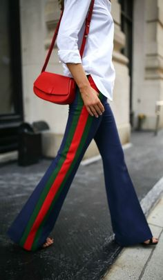 TREND MEMO: Luxe Leisure // Multi-colored striped flare pants, classic white button down, small red leather handbag, black ankle strap sandals, white sunglasses {Gucci, Steve Madden, Elizabeth and James, trend memo, fall winter fashion trends, classic style, athleisure}