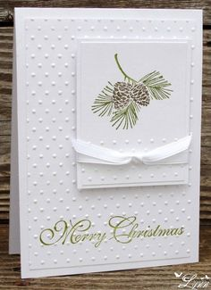 white on white dotted Swiss with pine cones (green needles & brown pine cones).  white ribbon, Merry Christmas (green)