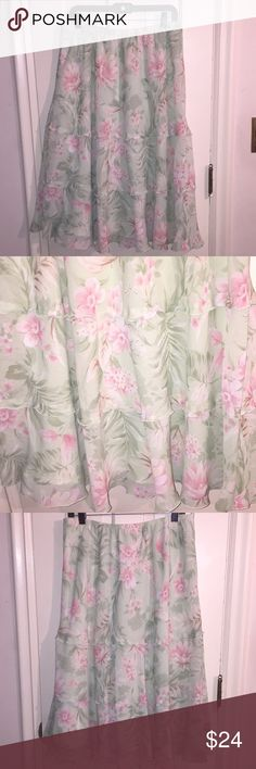 Soft and Lovely Pastel Skirt by Alfred Dunner Beautiful three-layered floral skirt by Alfred Dunner.  Soft Pastel green with pink and white flowers.  Made with attached slip.  Simply lovely.  Size 16P.  Shell and Lining are 100% Polyester. Alfred Dunner Skirts Midi